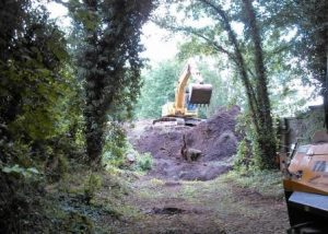 Work begins to remove the waste from the embankment