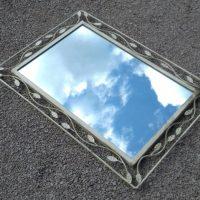 Mirror in metal frame