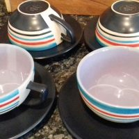 Four Coffee cups and saucers