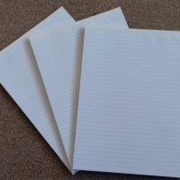 Three A4 ruled notebooks