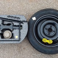 Car jack and spare wheel